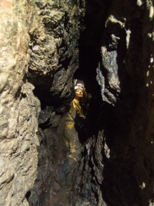 Sarah Payne in a natural rift broken into by the miners. Photo by Duncan Simey