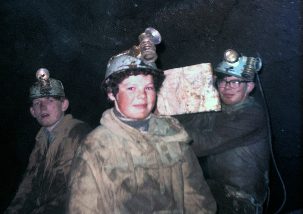 Michael Stower, Wendy Glanvill, Peter Glanvill in the Stream Chamber of Bakers Pit 11th March 1967. I am holding up a traced survey of the cave wrapped in polythene. I was wearing corduroy britches that kept falling down.