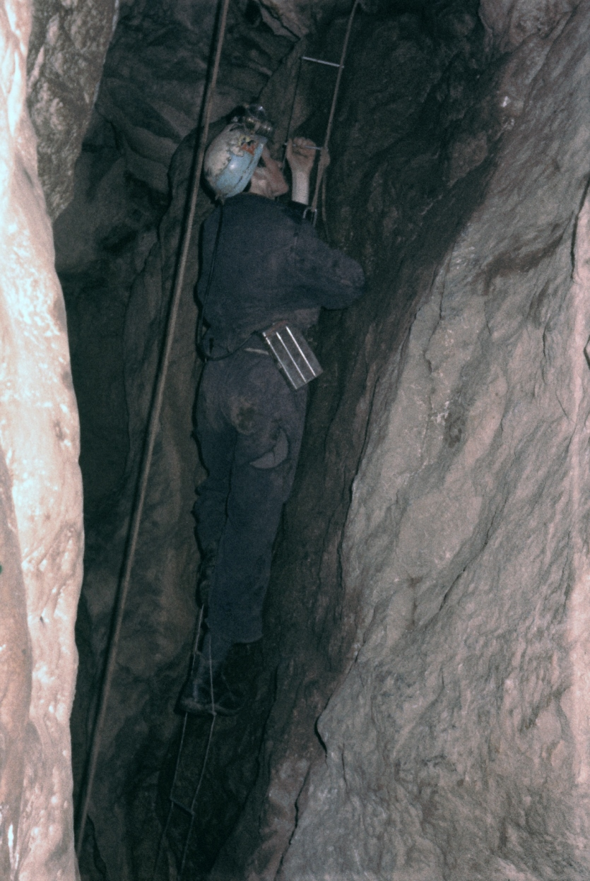 David Higginson climbing a pitch in Pixie's Hole Chudleigh. Note the Edison lamp on his waist. 5th January 1969.