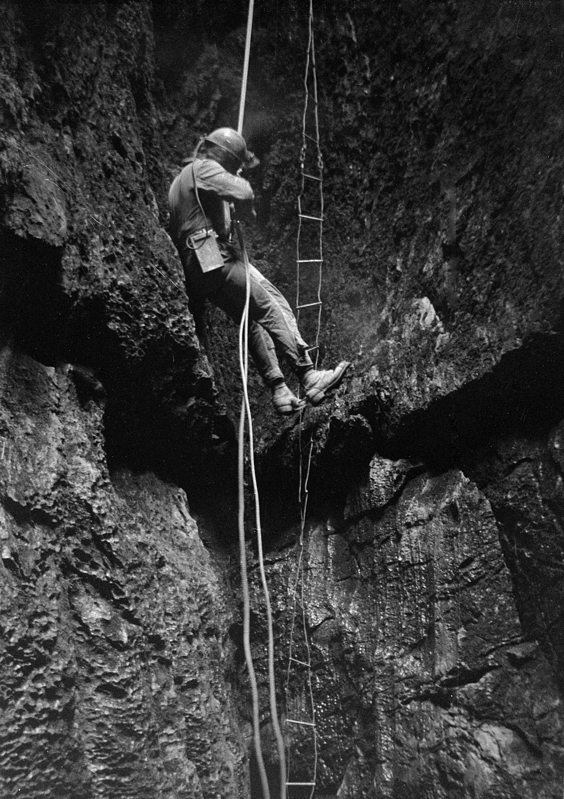 Meregill Hole 25th March 1972. The others abseiled with shiny new figure of eights whilst I was shown how to wrap my rope round a krab to do a classic abseil. We laddered out.