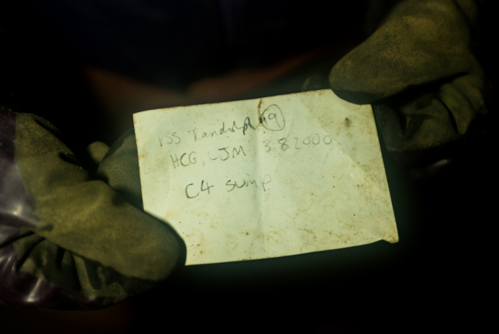 The survey note from Hilary and Lynn which Tony brought back from the far side of the C4 downstream sump (photo Paul Diffley)