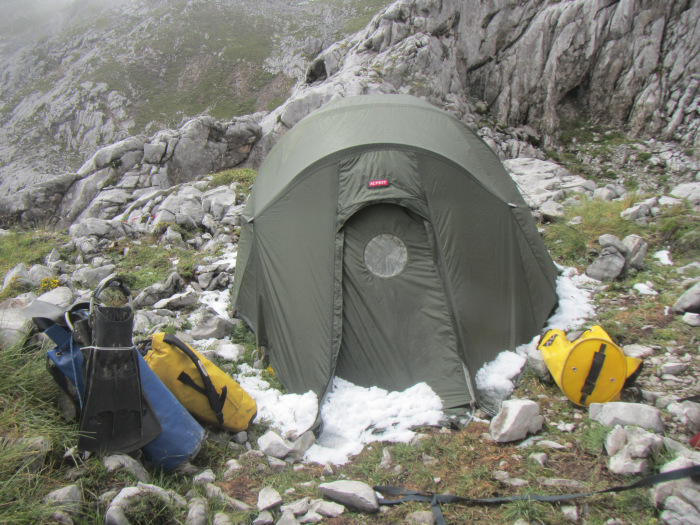 Snow and flippers: Alpkit tent by the entrance to C4 after the initial bad weather.